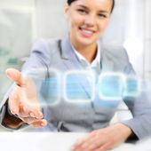 Attractive brunette with virtual interface in futuristic interior — Stock Photo