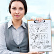 Business woman holding papers with sketches for her business — Stock Photo #11556156