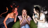Portrait of pretty woman sitting at home. Angel and devil talkin — Stock Photo