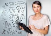 Geschäftsfrau, die planung mit ihrem tablettcomputer — Stockfoto
