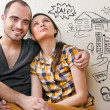 Closeup portrait of adult couple sitting on floor — Stock Photo