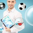 Adult handsome man holding tablet computer. Icons of different object are flying around. — Stock Photo #11678773