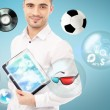 Adult handsome man holding tablet computer. Icons of different object are flying around. — Stock Photo #11678784