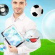 Adult handsome man holding tablet computer. Icons of different object are flying around. — Stock Photo #11678809