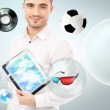 Adult handsome man holding tablet computer. Icons of different object are flying around. — Stock Photo #11678819