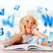 Portrait of a young girl in school at the desk. Reading book — Stock Photo