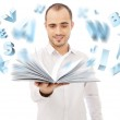 Adult man holding an opened book and reading. Letters are flying — Stock Photo