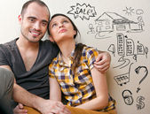 Closeup portrait of adult couple sitting on floor — Photo