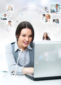 Business woman working with laptop at her office. Talking online — Stock Photo