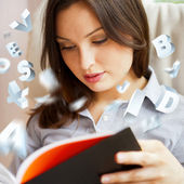 Young pretty woman reading book at home. Self education — Stock Photo