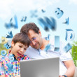 Closeup portrait of happy family: father and his son educating using laptop — Stockfoto