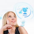 Young woman working with virtual interface against white backgro — Stock Photo