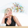 Young woman has images around her head representing entertainmen — Stock Photo #12033580