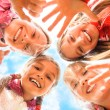 Happy children having fun together - Stock Photo