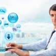 Business man working at his office using laptop and different ic — Stock Photo #12033714