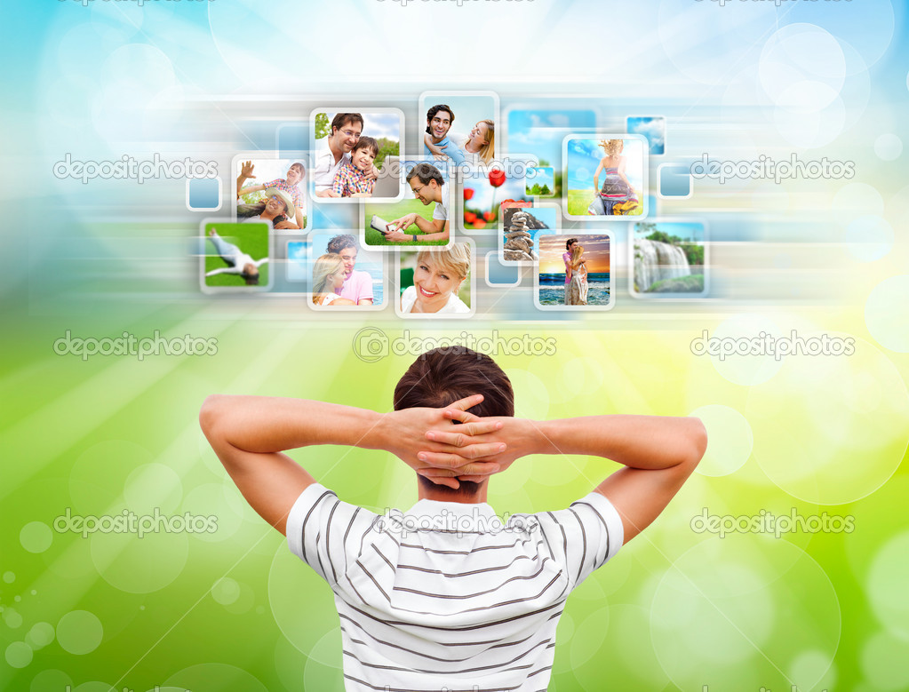 Young man standing in front of virtual preview of different images and choosing channel — Stock Photo #12033690