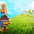 Young woman running across field to house and family of her dream — Stock Photo #12147445
