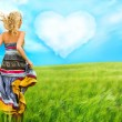 Portrait of romantic woman running across field to her love — Stockfoto