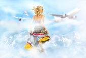 Young woman running through the clouds in the sky, birds and airplane flying at the background — Stock Photo