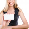 Young student woman showing blank business card to camera — Stock Photo #12174440