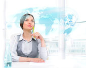 Businesswoman looking at high tech type of world map on a virtua — Stock Photo