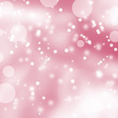 Pink winter background with lights and snowflakes — Stock Photo