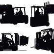 Four forklift truck silhouettes — Photo