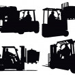 Stock Photo: Four forklift truck silhouettes