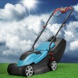 Lawnmower against blue sky and cumulus — Stok fotoğraf