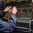 Stock Photo: Electrician testing industrial machine