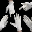 White-gloved hand on a black background — Stock Photo