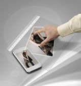 Closeup of hand touching screen on futuristic tablet — Stock Photo