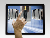 Holding and pointing to blank screen on digital tablet with copy — Stock Photo
