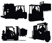 Four forklift truck silhouettes — Stock Photo