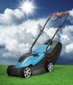 Lawnmower against blue sky and cumulus — Stock Photo