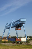 Industrial crane with flat containers — Stock Photo