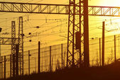 Railway electric wires and cables at sunset — Stock Photo