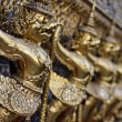 Thailand, Bangkok, Imperial City, Imperial Palace, golden statues on the external wall of a Buddhist temple - Stockfoto