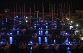 Italy, Siciliy, Mediterranean sea, Marina di Ragusa, view of luxury yachts in the marina by night — Stok fotoğraf