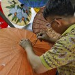 Thailand, Bangkok, a Thai artist decorating an umbrella in an umbrella factory — Stock Photo