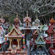 Thailand, Ayutthaya, these votive miniature temples are left in this sacred place by Thai in memory of their dead relatives - Foto Stock