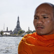 Thailand, Bangkok, Buddhist monk on a boat crossing the Chao Phraya river (Arun Temple in the background) — Stock Photo #10900453