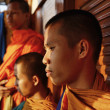 Stock Photo: Thailand, Bangkok, young Buddhist monks on boat crossing Chao Phrayriver at sunset