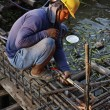 Thailand, Bangkok, a thai welder working at the contruction of a bridge on the Chao Phraya river — Stock Photo