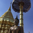 Thailand, Chiangmai, Prathat Doi Suthep Buddhist temple, golden roof and old Buddha statue — Stock Photo