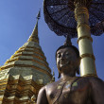 Thailand, Chiangmai, Prathat Doi Suthep Buddhist temple, golden roof and old Buddha statue — Stock Photo #11079009