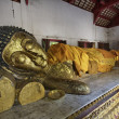 Thailand, Chiang Mai, a laying Buddha statue inside a small Buddhist temple — Stock Photo