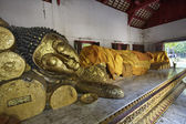 Thailand, Chiang Mai, a laying Buddha statue inside a small Buddhist temple — Stock Photo