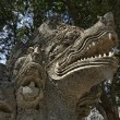 Thailand, Chiang Mai, U-Mong Temple, old dragon statue - Stock Photo