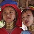 Stock Photo: Thailand, Chiang Mai, Karen Long Neck hill tribe village (KayLahwi), Long Neck young girls in traditional costumes. Women put brass rings on their neck when they are 5 or 6 years old and increase t